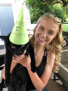 SIS student Katherine Emrich with her cat Loki